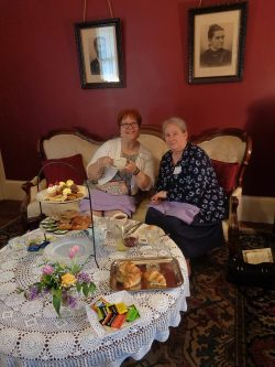 Ladies enjoying tea in the Jordan House Parlor