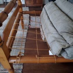 bed frame showing ropes and mattresses